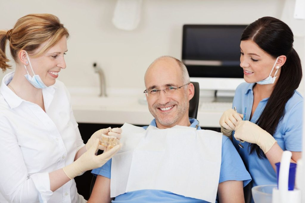 patient with two female dentists