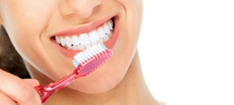woman brushing white teeth