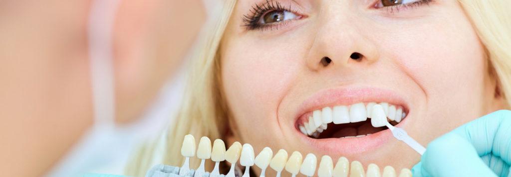 woman receiving dental implants from a hygieniest